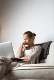 Very tired young woman, burning the midnigh oil Royalty Free Stock Photography