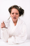 Very tired young woman holding a cup of coffee Stock Photos