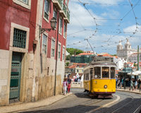 Very touristic place in the old part of Lisbon, with a traditional tram passing by in the city of Lisbon, Portugal. Stock Images
