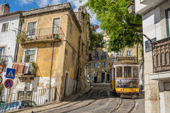 Very touristic place in the old part of Lisbon, with a traditional tram passing by in the city of Lisbon, Portugal. Royalty Free Stock Image