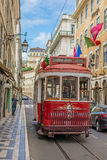 Very touristic place in the old part of Lisbon, with a traditional tram passing by in the city of Lisbon, Portugal. Stock Photos