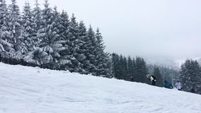 The very touristic ski slope of Winterberg, Hochsauerlandkreis, Germany, popular winter sport and holiday location. A very touristic ski slope of Winterberg stock video footage