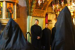 Very unusual black monks ritual in The Church of the Holy Sepulchre stock images