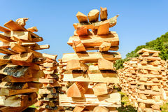 Very unusual way of stacking  cut wood logs Stock Photos
