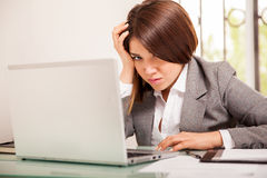 Very upset business woman at work Royalty Free Stock Photography