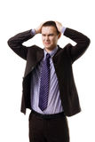 Very upset young man holding head with hands weari Stock Photo