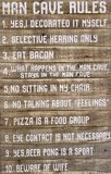 Very useful tips about man cave rules. A very useful tips about man cave rules print on wood Stock Images