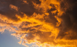 Very Vivid Golden Storm Clouds at Sunset on Windy Day Royalty Free Stock Photography