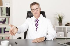 Very welcomimg family doctor Royalty Free Stock Photo