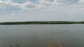 Very Wide River Panorama. A panorama of a very large river. Can be used the first part of clip and the end as static shots, and the middle part as pananoramic stock footage