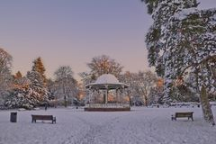 A winter bandstand. A very wintry scene of the bandstand in West Park, Wolverhampton, UK. The sunset lit up the backdrop with a lovely orange glow Royalty Free Stock Photo