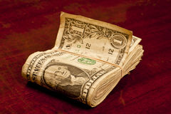 Very Worn Dollar Bills With Rubber Band Royalty Free Stock Photos