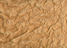 Very wrinkled sheet of brown paper Royalty Free Stock Photo