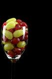 Very Yonge Wine. Red and green grapes in a wine glass Stock Images