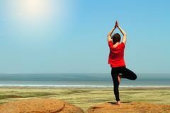 Very young fitness woman practice yoga at mountain peak Stock Photo