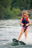 Very Young Girl Skiing. Cute little girl on skis, she doesn't like the water to spray in her eyes so she wears goggles Stock Photo