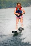 Very Young Girl Skiing. Cute little girl on skis, she doesn't like the water to spray in her eyes so she wears goggles Stock Image