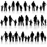 Verzamel familiesilhouetten Stock Foto's