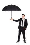 Verzekeringsagent die een paraplu houdt Royalty-vrije Stock Foto