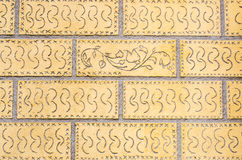 Verzierte Backsteinmauer Lizenzfreie Stockbilder