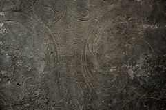 Verzierung auf alter Steinwand Stockbild