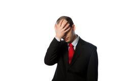 Verzweifelter Geschäftsmann mit Gesicht in seiner Palme Stockfoto
