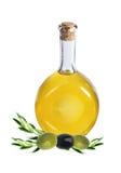 Verzweigen Sie sich mit Oliven und einer Flasche Olivenöl Lizenzfreies Stockbild