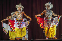 Ves Dancers perform at the Esala Perahera theatre show in Kandy, Sri Lanka. Royalty Free Stock Photography