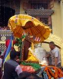 Vesak Buddhist Holiday Kathmandu Nepal. Buddha statue being dressed for a procession marking part of the Buddhist religious holiday Vesak in Boudhanath Royalty Free Stock Photo