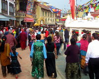 Vesak Buddhist Religious Holiday Kathmandu Nepal. Crowd of devotees in colorful traditional regional ethnic costume participate in festivities on the Buddhist Stock Photo