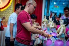 Vesak Day Bathing the Buddha Stock Image