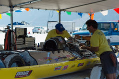 Vesco crew members working on their famous yellow racing car Stock Photography