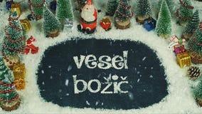 Vesel BoÅ ¾ iÄ 斯洛文尼亚的停止运动动画,用英语圣诞快乐 库存照片