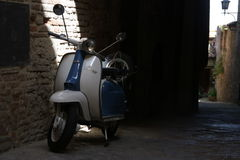 Vespa in  authentic Tuscany town Stock Images