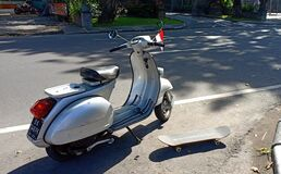 Vespa clasic and skateboard