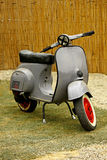 Vespa motorcycle. Classic vintage bike on the grass Stock Photography