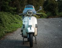 White vintage scooter front view stock photography