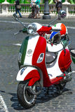Vespa scooter 50 years 60 old. Dress with flag colors of Italians Royalty Free Stock Photography