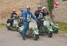 Vespa, vintage, italy, scooter, classic, biker, bike, italian, a. Bikers at the time control riding a vintage italian scooters in rally of classic Vespa of the Royalty Free Stock Image