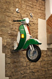 Vespa on the wall Royalty Free Stock Photos