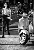 Vespa y muchacha Foto de archivo