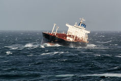 Vessel at anchor in storm weather Royalty Free Stock Photography