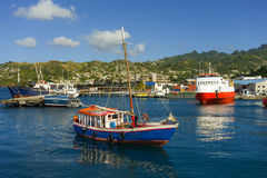 A vessel approaching the customs jetty at kingstown, st. vincent Royalty Free Stock Photos