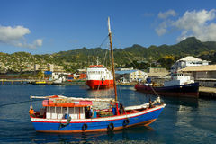A vessel approaching the customs jetty at kingstown, st. vincent Stock Photography