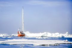 Vessel of the Arctic expedition in the waters of the Arctic Ocean royalty free stock photo