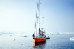 Vessel of the Arctic expedition in the waters of the Arctic Ocean. Coast of the Arctic Ocean, Russia - December 14, 2016: Vessel of the Arctic expedition in the royalty free stock image