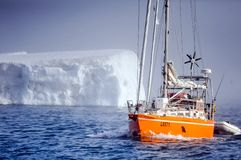 Vessel of the Arctic expedition in the waters of the Arctic Ocean stock photo