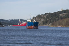 Cargo vessels arriving at the port of halden Stock Photos