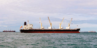 Vessel bulk cargo with crane Royalty Free Stock Photography