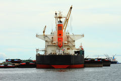 Vessel cargo with crane are working in the sea. Stock Photo